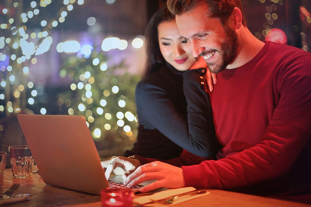 Smiling couple on a computer